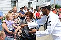 US Navy 110704-N-GA722-456 Information Technician 2nd Class Ryan Flowers interacts with a child during the Independence Day Parade in Eastport, Mai.jpg
