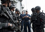US Navy 110921-N-HA376-268 Lt. j.g. David Zicarelli, assigned to the guided-missile frigate USS Ford (FFG 54), debriefs Bangladesh Navy Special War