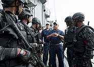 US Navy 110921-N-HA376-268 Lt. j.g. David Zicarelli, assigned to the guided-missile frigate USS Ford (FFG 54), debriefs Bangladesh Navy Special War
