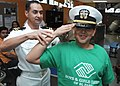 US Navy 111018-N-BX435-043 Lt. Arturo Lopez, assigned to Navy Operational Support Center El Paso, helps a child salute correctly at Club Delta Boys.jpg