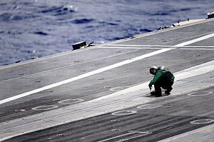 US Navy 111228-N-JN664-191 A Sailor prepares the flight deck of the Nimitz-class aircraft carrier USS Abraham Lincoln (CVN 72) for flight operation.jpg