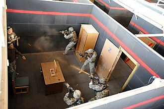 10th Special Forces Group (United States) - Special Forces soldiers from 3rd Battalion, 10th Special Forces Group (Airborne), conduct shoot-house training at Fort Carson in September 2009