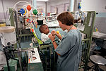 Wilford Hall. 1LT Amy Parish plays with a baby who has a tracheotomy in his throat while in a long-term care unit of a nursery DF-SC-82-04969.jpg