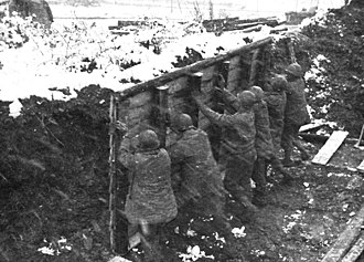 395th Infantry Regiment (United States) - Soldiers constructing a winterized hut near the front lines in the 99th Divisions' sector.