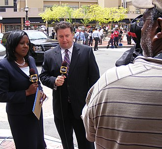 WMAR-TV - WMAR-TV anchors Kelly Swoope and Jamie Costello prepare for live shot in downtown Baltimore, April 27, 2011.