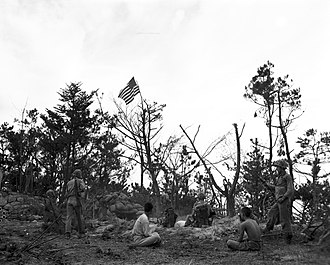 Wolmido - U.S. Marines and a planted flag atop Wolmi Island, at Inchon in 1950