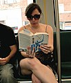 Woman reading Atlas Shrugged on the MBTA Green Line, July 2006.jpg