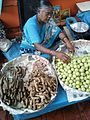 Woman selling amla ginger nannari at gandhi bazar.jpg
