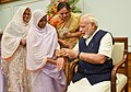 Women tying 'Rakhi' on the Prime Minister, Shri Narendra Modi's wrist, on the occasion of 'Raksha Bandhan', in New Delhi on August 07, 2017.jpg