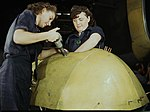 Working on a Vengeance dive bomber, Vultee 1a35368v (cropped).jpg