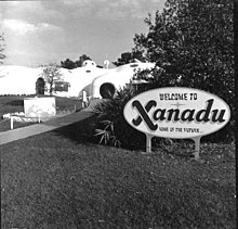 A photo of a welcome sign and entry path for the Xanadu house in Kissimmee, Florida.