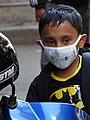 Young Boy with Anti-Pollution Mask on Motorbike - Kathmandu - Nepal (13465525004).jpg