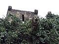 017 Castell de Santa Florentina (Canet de Mar), façana est, gàrgola, merlet i espitllera.JPG