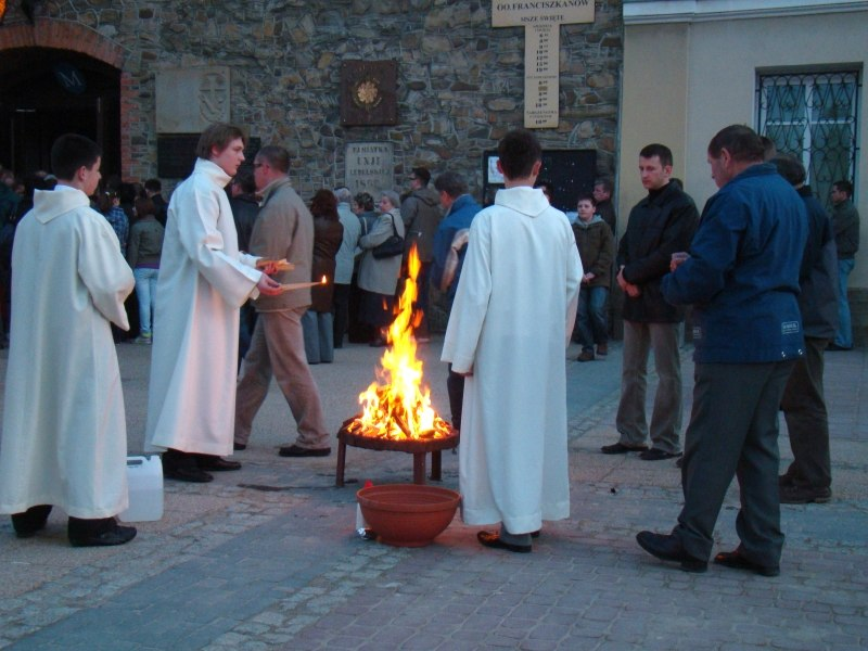098 Sanok, Diacons preparing to light the Christ candle prior to Easter Vigil mass, 2010