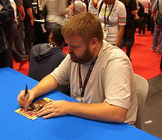 The Walking Dead (comic book) - Co-creator Robert Kirkman signing a copy of the first issue at the 2011 New York Comic Con.