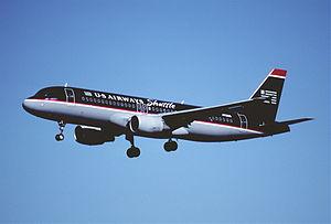 US Airways Shuttle - A US Airways Shuttle Airbus A320-200 landing at LaGuardia Airport (2001)