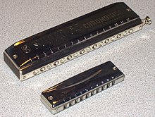 A 16-hole chromatic (top) and 10-hole diatonic harmonica