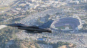 2017 World Series - A F-16 Fighting Falcon flies past Dodger Stadium during the pre-game ceremonial flyover before Game 2.