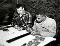 1957. A method of sampling an 18-inch western hemlock twig for black-headed budworm eggs. V. Carolin (left) and C. Williams. Sellwood Lab. Portland, Oregon. (33398002292).jpg