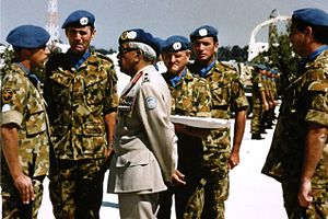 Australian contribution to UNTAG - Members of the first Australian contingent Headquarters Chief Engineer UNTAG being awarded their UN medal by Lieutenant-General Dewan Prem Chand at a parade at the UNTAG Headquarters in Suiderhof, Windhoek, Namibia in 1989. Left to right: Major John Hutchings, Lieutenant-Colonel Kevin Pippard, Warrant Officer Class 2 Peter Bruce, Lieutenant-General Dewan Prem Chand, Colonel Richard Warren and Sergeant Steven Lavery