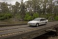 1990 Holden VN Berlina crossing the Low-level Bridge over the Lachlan River in Cowra.jpg