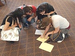 Scavenger hunt - Scavenger hunt participants cross an item off their list.
