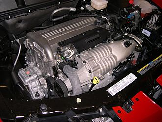 Supercharger - An Eaton MP62 Roots-type supercharger is visible at the front of this Ecotec LSJ engine in a 2006 Saturn Ion Red Line.