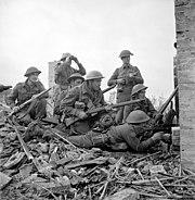 48th Highlanders of Canada Lieutenant preparing to give order to infantrymen San Leonardo Ortona December 1943