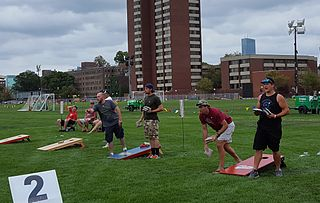 Cornhole lawn game in which players take turns throwing bags of corn (or bean bags)