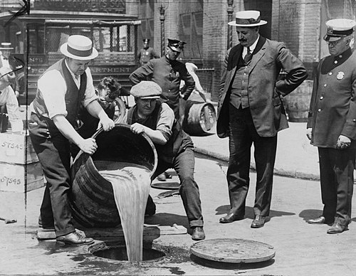 Prohibition agents emptying barrels of alcohol. 5 Prohibition Disposal(9) (cropped).jpg