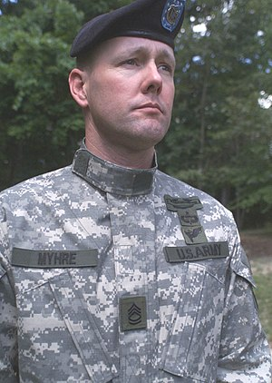 Mandarin collar - U.S. Army soldier shown wearing the Army Combat Uniform (ACU) uniform with the coat's mandarin collar worn in the upright position as required when wearing protective combat gear