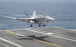 A U.S. Navy F-A-18E Super Hornet aircraft assigned to Strike Fighter Squadron (VFA) 147 prepares to land aboard the aircraft carrier USS Nimitz (CVN 68) Aug. 19, 2013, in the U.S. 5th Fleet area 130819-N-AZ866-337.jpg