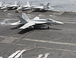 A U.S. Navy F-A-18E Super Hornet aircraft attached to Strike Fighter Squadron (VFA) 147 lands on the flight deck of the aircraft carrier USS Nimitz (CVN 68) in the Gulf of Oman July 31, 2013 130731-N-TW634-015.jpg