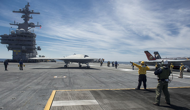 File:A U.S. Navy X-47B Unmanned Combat Air System demonstrator aircraft, center, taxis on the flight deck of the aircraft carrier USS George H.W. Bush (CVN 77) May 14, 2013, in the Atlantic Ocean 130514-N-FU443-684.jpg