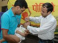 A child is being administered Polio Vaccine by a volunteer at a centre, in New Delhi on March 30, 2008.jpg