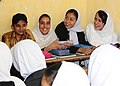 A classroom of Afghan students share a laugh during a visit from Afghan National Civil Order Police and Coalition Forces. (4677626513).jpg