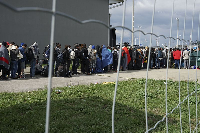 File:A line of Syrian refugees crossing the border of Hungary and Austria on their way to Germany. Hungary, Central Europe, 6 September 2015.jpg