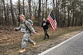 A man carrying an American flag follows a U.S. Soldier during the Maryland Army National Guard's March Against Hunger in La Plata, Md., March 16, 2013 130316-A-JM202-062.jpg