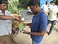 A man selling palm juice.jpeg