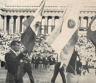 1959 Pan American Games - Opening ceremonies at Soldier Field. Wrestler Mario Tovar González can be seen serving as Mexico's flag bearer.