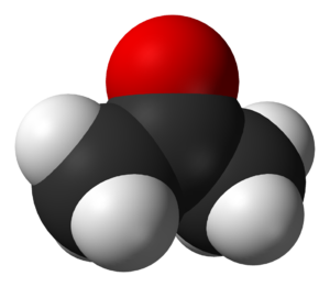 A ball structure of a molecule. Its backbone is a zig-zag chain of three carbon atoms connected in the center to an oxygen atom and on the end to 6 hydrogens.