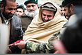 Afghan military and civilian leaders cut a ceremonial ribbon during an opening ceremony for the Regional Artillery Training Center, a field artillery training center at Camp Eagle in Zabul province, Afghanistan 131230-Z-HP669-004.jpg