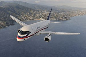 Sukhoi Superjet 100 - Image: Air to air photo of a Sukhoi Superjet 100 (RA 97004) over Italy