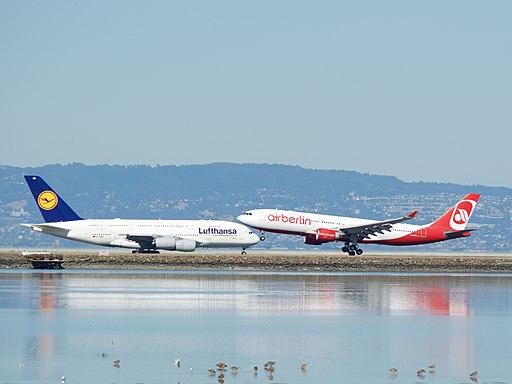 Air Berlin A-330 landing Lufthansa Airbus A-380 taxiing to takeoff runway 28 SFO (30144412484)