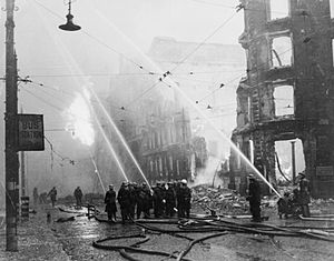 4th Anti-Aircraft Division (United Kingdom) - Firefighters putting out a blaze at a bomb site in Manchester city centre