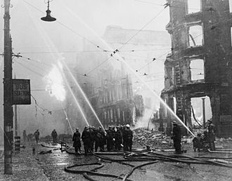 Manchester Blitz - Firefighters putting out a blaze at a bomb site in Manchester city centre