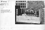 Airplanes - Manufacturing Plants - Curtiss OX-5 training plane motor. Each engine is packed for shipment in a stoutly built box lined with water proof tar paper - NARA - 17339474.jpg