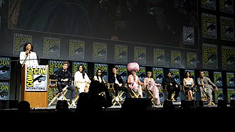 Fantastic Beasts: The Crimes of Grindelwald - Cast of Fantastic Beasts: The Crimes of Grindelwald at the 2018 San Diego Comic-Con. From left to right: Eddie Redmayne, Claudia Kim, Zoë Kravitz, Callum Turner, Ezra Miller, Alison Sudol, Dan Fogler, Katherine Waterston and Jude Law