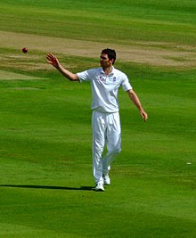 A photograph of James Anderson bowling against Australia in August 2009