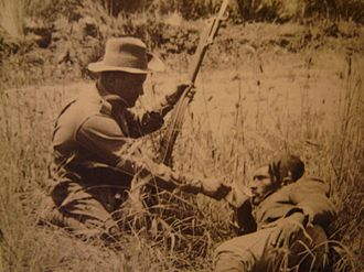 Anzac spirit - An ANZAC soldier gives water to a wounded Turk.